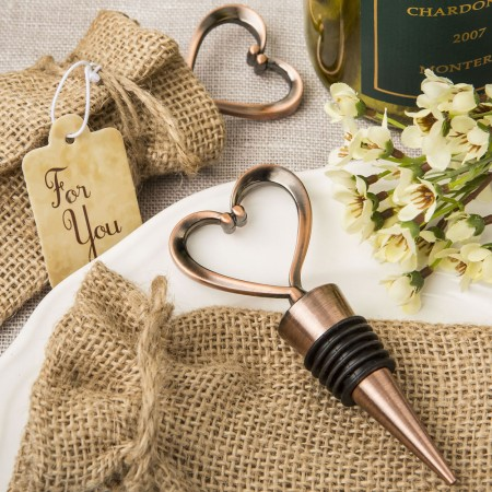 Heart shaped metal bottle stopper in a Copper plated finish in a burlap bag200  Weddings